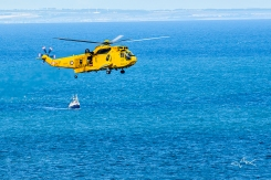 rescue helicopter and trawler